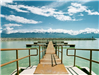 Dock Area On Lake With Mountain Range in Background