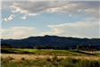 Early Evening View of Golf Course and Mountain Range