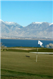 Golf Course Hole Area With Lake and Mountain Range in Background