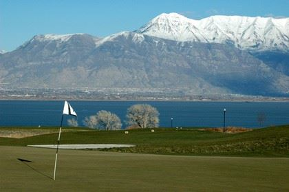 Golf Course With Large Lake in the Background and Mountain Range