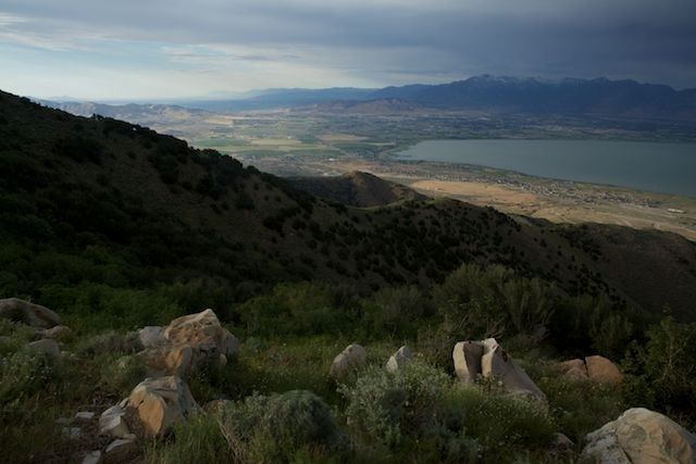 Grassy Mountain And View of Lake and Mountain Range