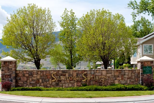Saratoga Springs Sign With Trees in Background