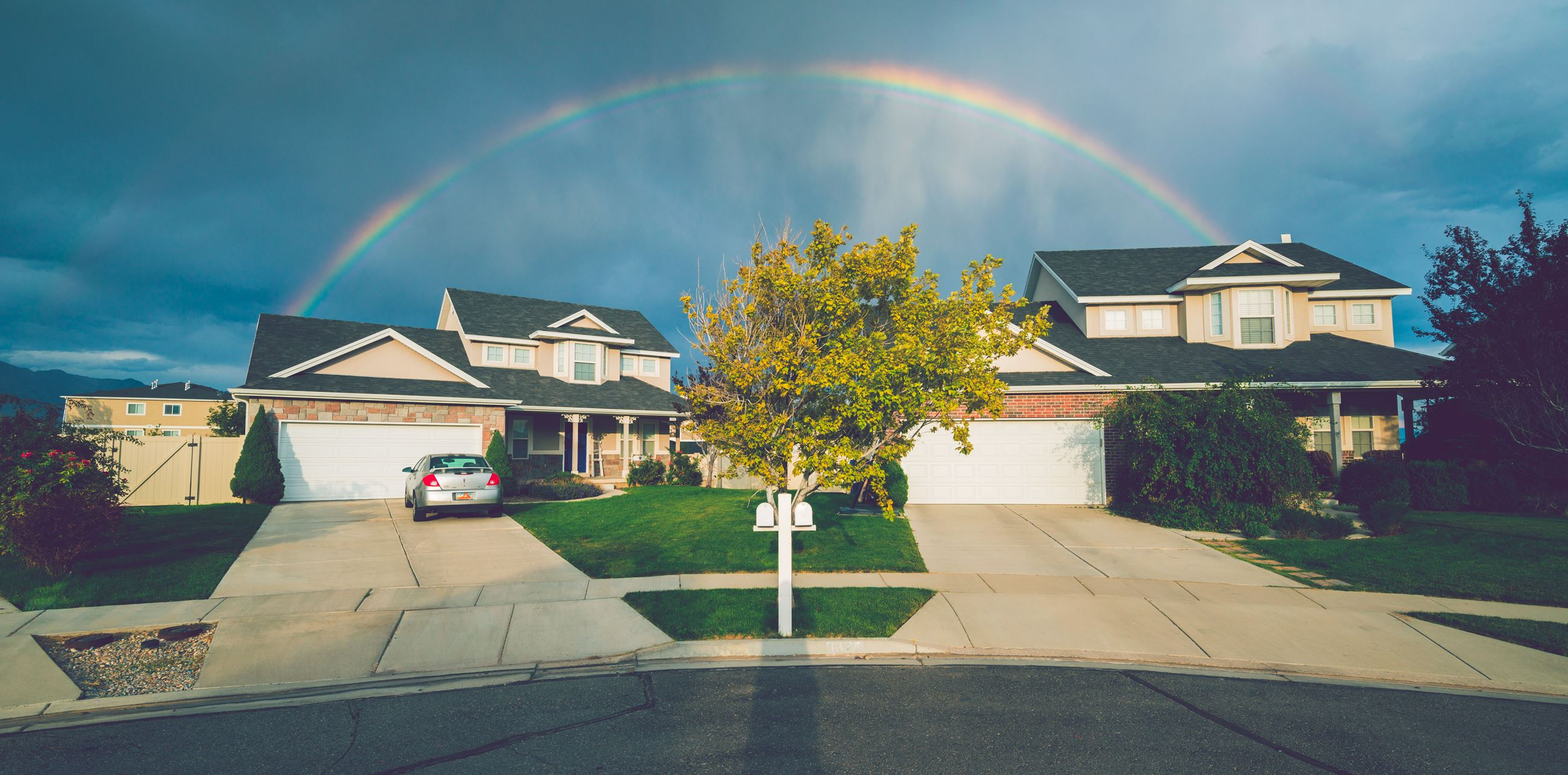 Rainbow over House, Photo by Ken Harvey
