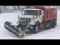 Snow Plow Driving Down Road