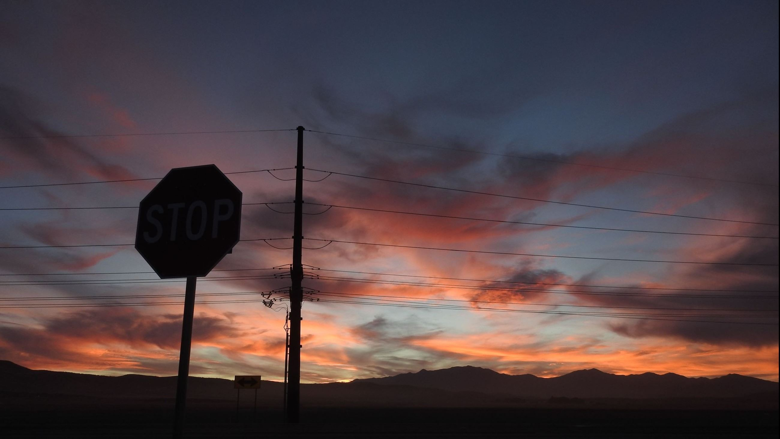 Sunset on behind the stop sign PC: Ann Carter